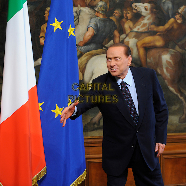 SILVIO BERLUSCONI.Italian Premier  meets the Chairman of the US Senate Foreign Relations Committee, John Kerry, D-Mass, in Rome, Italy, Good Friday, .22nd April 2011..half length hand suit tie navy blue prime minister reaching arm .CAP/EPS/DS.©Danilo Schiavella/EPS/Capital Pictures