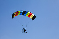 Colorful Powered Parachute in Flight, Arlington, Washington State, WA, America, USA.