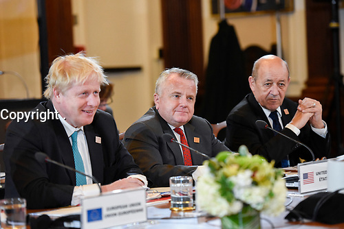 Acting Secretary of State John Sullivan (M) participates in the G-7 Foreign Ministers' Working Session on the Middle East, in Toronto, Canada, April 22, 2018. U.K. Foreign Secretary Boris Johnson (L)and French Minister of Europe and Foreign Affairs Jean-Yves Le Drian (R) are seated next to him.