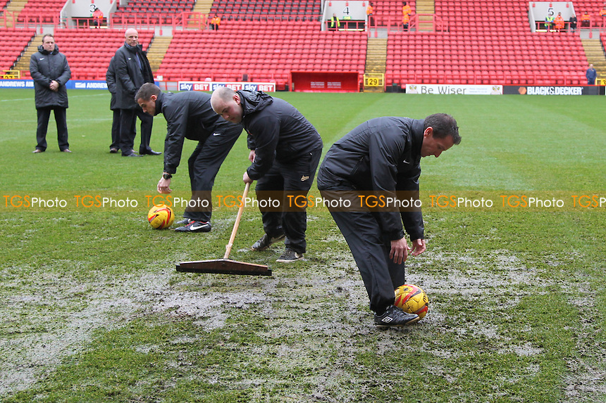 Ref Keith Stroud tests the surface while ground staff attempt to clear the pitch - Charlton Athletic vs Leeds United - Sky Bet Championship Football at The Valley, London - 09/11/13 - MANDATORY CREDIT: Simon Roe/TGSPHOTO - Self billing applies where appropriate - 0845 094 6026 - contact@tgsphoto.co.uk - NO UNPAID USE