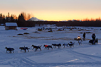 Magnus Kaltenborn leaves the Nikolai checkpoint in the early hours on Wednesday during Iditarod 2011 with Mt. Mckinley and the Alaska Range in the background.
