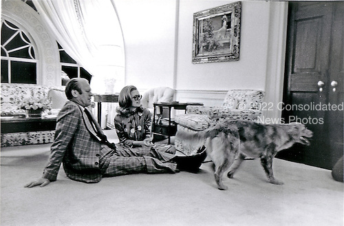 United States President Gerald R. Ford and his daughter, Susan Ford, sit on the floor of the Great Hall in the private area of the White House in Washington, D.C. while their pet golden retriever &quot;Liberty&quot; is on the scene on October 5, 1974.<br /> Mandatory Credit: David Hume Kennerly / White House via CNP