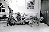 "United States President Gerald R. Ford and his daughter, Susan Ford, sit on the floor of the Great Hall in the private area of the White House in Washington, D.C. while their pet golden retriever ""Liberty"" is on the scene on October 5, 1974.<br /> Mandatory Credit: David Hume Kennerly / White House via CNP"