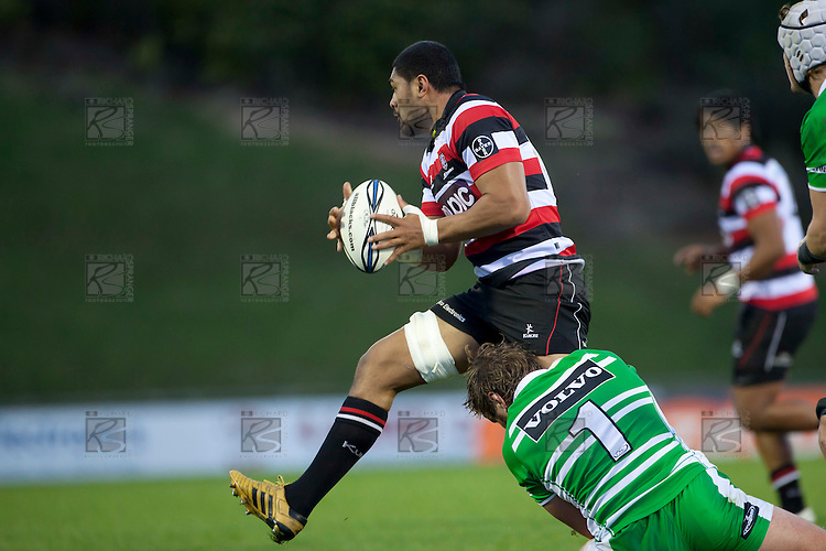 Fritz Lee tries to step out of Grant Polson's tackle. ITM Cup rugby game between Counties Manukau and Manawatu played at Bayer Growers Stadium on Saturday August 21st 2010..Counties Manukau won 35 - 14 after leading 14 - 7 at halftime.