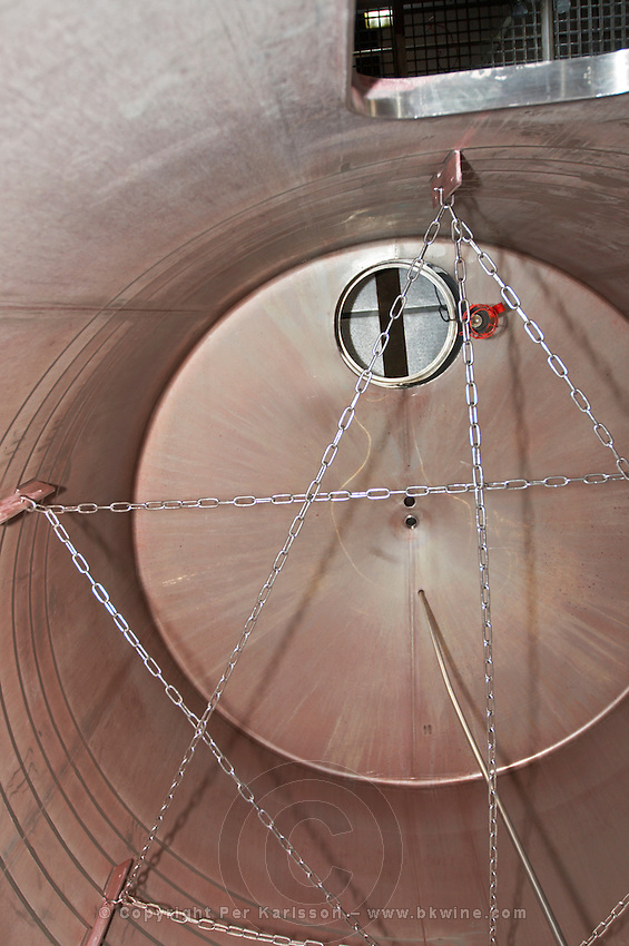 fermentation tank interior chains to break the cap at rack-and-return chateau lestrille bordeaux france