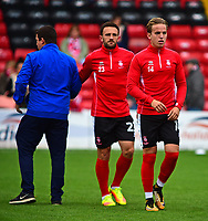 Lincoln City's Neal Eardley and Jordan Maguire-Drew during the pre-match warm-up<br /> <br /> Photographer Andrew Vaughan/CameraSport<br /> <br /> The EFL Sky Bet League Two - Lincoln City v Chesterfield - Saturday 7th October 2017 - Sincil Bank - Lincoln<br /> <br /> World Copyright &copy; 2017 CameraSport. All rights reserved. 43 Linden Ave. Countesthorpe. Leicester. England. LE8 5PG - Tel: +44 (0) 116 277 4147 - admin@camerasport.com - www.camerasport.com