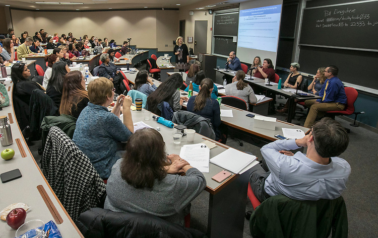 "Conference attendees pose questions during a panel discussion as professionals gather to discuss the link between domestic violence and brain injuries, Wednesday, Feb. 28, 2018, at the DePaul Center on the university's Loop Campus. The gathering, ""The Intersection of Traumatic Brain Injury and Domestic Violence,"" brought various community agencies that service victims of domestic violence together with healthcare providers, faculty and students at DePaul and other universities. The participants discussed the links between brain injury and domestic violence and learned new approaches to help survivors and their families. (DePaul University/Jamie Moncrief)"