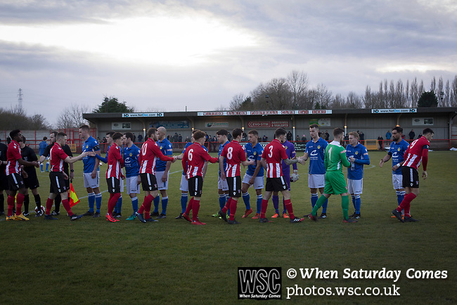 Witton Albion 1 Warrington Town 2, 26/12/2017. Wincham Park, Northern Premier League. The two teams exchange handshakes at Wincham Park, home of Witton Albion (in red) before their Northern Premier League premier division fixture with Warrington Town. Formed in 1887, the home team have played at their current ground since 1989 having relocated from the Central Ground in Northwich. With both team chasing play-off spots, the visitors emerged with a 2-1 victory, the winner being scored by Tony Gray in second half injury time, watched by a crowd of 503. Photo by Colin McPherson.