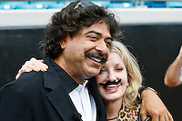 September 16, 2012:   Jacksonville Jaguars owner Shadid Khan and his wife Ann pose for photos on the sidelines before the start of action between the Jacksonville Jaguars and the Houston Texans played at EverBank Field in Jacksonville, Florida.  Houston defeated Jacksonville 27-7.........