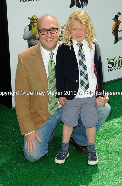 "UNIVERSAL CITY, CA. - May 16: Mike Mitchell (director) and Ollie Mitchell (castmember voiceover) arrive at the ""Shrek Forever After"" Los Angeles Premiere at Gibson Amphitheatre on May 16, 2010 in Universal City, California."