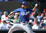 Los Angeles Dodgers&rsquo; Luis Avilan pitches in a spring training game in Scottsdale, Ariz., on Friday, March 18, 2016. <br />Photo by Cathleen Allison
