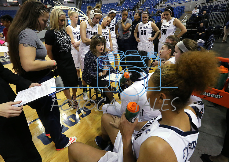 Nevada Head Coach Jane Albright, center, talks to her team during a women's basketball game against Air Force in Reno, Nev., on Saturday, Jan. 9, 2016. Nevada won 68-57.<br />