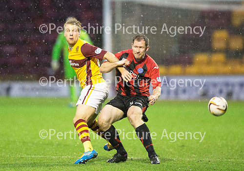Motherwell v St Johnstone.....01.01.14   SPFL<br /> Henri Anier and Frazer Wright<br /> Picture by Graeme Hart.<br /> Copyright Perthshire Picture Agency<br /> Tel: 01738 623350  Mobile: 07990 594431