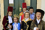 The Synagogue of the Premishlan congregation on Purim holiday, Hasidic boys in costume