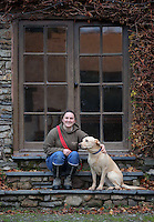 FAO JANET TOMLINSON, DAILY MAIL PICTURE DESK<br />Pictured: A farm employee with one of the dogs Wednesday 23 November 2016<br />Re: The Dog House in the village of Talog, Carmarthenshire, Wales, UK