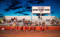 Greeley County High School cheer leaders during an eight man football game in Tribune, Kansas, Friday, October 13, 2013. The challenges of depopulation in the rural Midwest and Great Plains continue to grow as counties increasingly see more deaths than births. Greeley County, Kansas's least populated county, and the state as a whole are mounting a new fight to stem losses and finding early success. <br /> <br /> Photo by Matt Nager