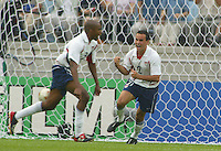 Landon Donovan and Eddie Pope celebrate John O'Brien's goal during the USA victory 3-2 over Portugal at the World Cup 2002 in Korea, June 5, 2002.