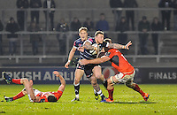 Sale Sharks Josh Charnley with the ball tackled by Saracen's No 7 Shalk Burger during the European Rugby Champions Cup match between Sale Sharks and Saracens at AJ Bell Stadium, Salford, England on 18 December 2016. Photo by Paul Bell.