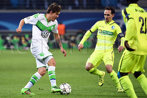 17.02.2016. Gent, Belgium. UEFA Champions League football. KAA Gent versus VfL Wolfsburg.  Max Kruse forward of VfL Wolfsburg challenged by Kums Sven midfielder of KAA Gent