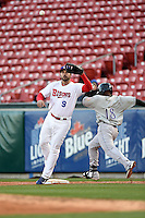 Buffalo Bisons outfielder Matt Tuiasosopo (9) waits for a throw as third baseman Ruben Gotay (18) reaches the bag during a game against the Louisville Bats on April 29, 2014 at Coca-Cola Field in Buffalo, New  York.  Buffalo defeated Louisville 4-1.  (Mike Janes/Four Seam Images)