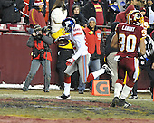 Landover, MD - December 21, 2009 -- New York Giants wide receiver Mario Manningham (82) scores a third quarter touchdown against the Washington Redskins at FedEx Field in Landover, Maryland on Monday, December 21, 2009.  The Giants won the game 45 - 12..Credit: Ron Sachs / CNP.(RESTRICTION: NO New York or New Jersey Newspapers or newspapers within a 75 mile radius of New York City)