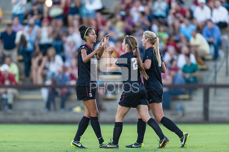 September 6, 2013: Courtney Verloo and Megan Turner celebrate a goal during the Stanford vs Loyola Marymount women's soccer match in Stanford, California.  Stanford won 4-0.