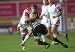 Dragons outside half Lewis Robling stops Ulster flanker Chris Henry..Celtic Laegue.Newport Gwent Dragons v Ulster.Rodney Parade.26.10.12.©Steve Pope