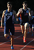 Clayton Santiago of Bethpage, left, legs out a victory in the Division 1 boys 800 meter race during Day 1 of the Nassau County track & field individual championships and state qualifiers at North Shore High School in Glen Head on Wednesday, May 30, 2018.