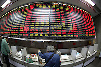 Investors make trades on computer terminals at a securities exchange in Shanghai, China..29 Oct 2007