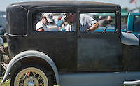 NWA Democrat-Gazette/ANTHONY REYES • @NWATONYR<br /> Craig Kruger, left, and Rick Shaffer look at Model A Ford Thursday, Sept. 17, 2015 at the Foot Hills of the Ozarks Swap Meet at Parsons Stadium in Springdale. The pair have their own booth at the swap meet but took a minute to look at a neighboring booth. The meet continues today and Saturday.
