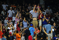 Apr. 30, 2011; Houston, TX, USA: Fans leap to catch the home run hit by Milwaukee Brewers batter Prince Fielder (not pictured) in the ninth inning against the Houston Astros at Minute Maid Park. The Astros defeated the Brewers 2-1. Mandatory Credit: Mark J. Rebilas-