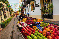 A Colombian vendor pushes a cart loaded with fruits for sale on the street of Getsemaní, a popular artistic neighborhood in Cartagena, Colombia, 16 December 2017. With the peace agreement, ending a 52-year civil conflict and promising political stability, together with rapid economic growth and unexploited tourism potential, Colombia has truly become a holiday destination. Cartagena, a UNESCO World Heritage site on the tropical Caribbean coast, plays the primary role in Colombia's tourism renaissance. The historic sites from the Spanish colonial times are being restored, private investments are visible throughout the city and an increased number of local people benefit from the boom of the travel related services.