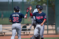Cleveland Indians shortstop Tyler Freeman (7) high fives George Valera (32) after scoring a run during an Extended Spring Training game against the Arizona Diamondbacks at the Cleveland Indians Training Complex on May 27, 2018 in Goodyear, Arizona. (Zachary Lucy/Four Seam Images)