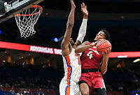 NWA Democrat-Gazette/CHARLIE KAIJO Arkansas Razorbacks guard Daryl Macon (4) leaps for a layup during the Southeastern Conference Men's Basketball Tournament quarterfinals, Friday, March 9, 2018 at Scottrade Center in St. Louis, Mo.