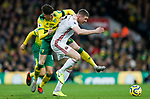 John Lundstram of Sheffield United battles with Ben Godfrey of Norwich City during the Premier League match at Carrow Road, Norwich. Picture date: 8th December 2019. Picture credit should read: James Wilson/Sportimage
