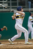 Michigan Wolverines shortstop Travis Maezes (9) swings the bat during the NCAA baseball game against the Washington Huskies on February 16, 2014 at Bobcat Ballpark in San Marcos, Texas. The game went eight innings, before travel curfew ended the contest in a 7-7 tie. (Andrew Woolley/Four Seam Images)