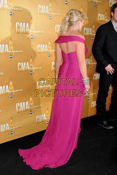 MIRANDA LAMBERT .44th Annual CMA Awards, Country Music's Biggest Night, held at Bridgestone Arena, Nashville, Tennessee, USA, 10th November 2010..CMAs country music full length pink magenta long maxi dress off the shoulder side bracelet backless cut out back rear behind .CAP/ADM/LF.©Laura Farr/AdMedia/Capital Pictures.