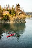 USA, Alaska, Homer, China Poot Bay, Kachemak Bay, a kayaker out in the water off of Kachemak Bay Wilderness Lodge