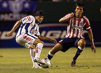 Pachuca midfielder Damien Alvarez (7) moves around Chivas USA defender Claudio Suarez (2). Pachuca CF defeated the Chivas USA 2-1 during the 1st round of the 2008 SuperLiga at Home Depot Center stadium, in Carson, California on Sunday, July 13, 2008.