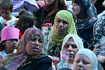 Palestinian women attend a celebration at Al-Walajah school on the occasion of Mother Day in Walajah village near the West Bank city of Bethlehem on March 21, 2011. Photo by Issam Rimawi