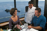 A couple choose sustainable seafood at a restaurant.