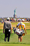 30 August 2009: Paul Goydos and his caddie walk to the 2nd green during the final round of The Barclays PGA Playoffs at Liberty National Golf Course in Jersey City, New Jersey.