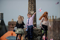 Wednesday 26 March 2014<br /> Pictured: A young boy waves a flag as the soldiers march through the City<br /> Re: 236 Signal Squadron ( part of 14 Signal regiment who are based at Cawdor Barracks in Brawdy Parade through the streets of  St.Davids Pembrokeshire led by Haverfordwest Air Training Corps Band and are then Presented with medals