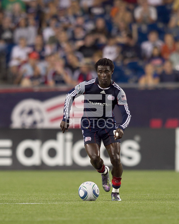 New England Revolution defender Emmanuel Osei (5) brings the ball forward. The New England Revolution defeated DC United, 1-0, at Gillette Stadium on August 7, 2010.