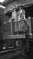 Two women, 1930's, stand at the rear of a train car.  (photo: www.bcpix.com)