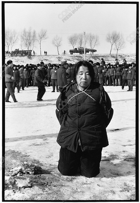 Wang Shouxin is unloaded onto a snowy field thirty kilometers southeast of Harbin and waits for her sentence to be carried out. Outskirts of Harbin, 8 February 1980