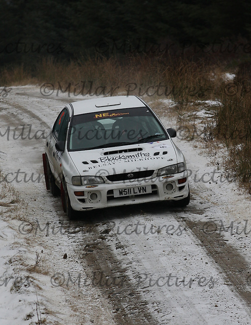 Joanna Wickham - Paul Banks at junction 8 on Special Stage 4 Bewshaugh on the Brick & Steel Border Counties Rally 2013, Round 2 of the RAC MSA Scottish Rally Championship sponsored by ARR Craib Transport Limited which was organised by Whickham & District and Hawick & Border Car Clubs and based in Jedburgh and held in Kielder Forest on 22.3.13.