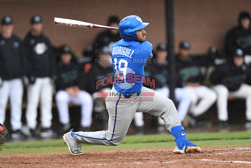 Third baseman Alex Rodriguez (19) of the Kentucky Wildcats bats in a game in the rain against the University of South Carolina Upstate Spartans on Saturday, February 17, 2018, at Cleveland S. Harley Park in Spartanburg, South Carolina. Kentucky won, 6-5, in 10 innings. (Tom Priddy/Four Seam Images)