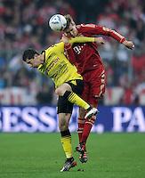 FUSSBALL   1. BUNDESLIGA  SAISON 2011/2012   13. Spieltag FC Bayern Muenchen - Borussia Dortmund        19.11.2011 Robert Lewandowski (li, Borussia Dortmund) gegen Holger Badstuber (FC Bayern Muenchen)