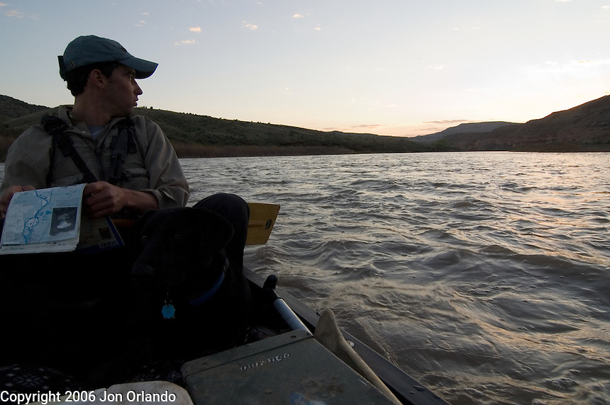 Dave Gentempo and his dog Charlie enjoy the last light while looking for a campsite in Horsethief Canyon on the Colorado River in western Colorado